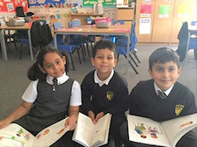 Children enjoying reading books